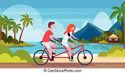 couple in love riding tandem bicycle summer vacation sea beach landscape beautiful seaside man woman lovers cycling twin bike horizontal flat