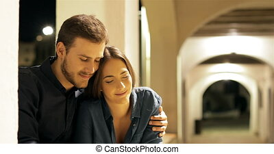 Couple in love sitting in a town the night - Happy couple in...