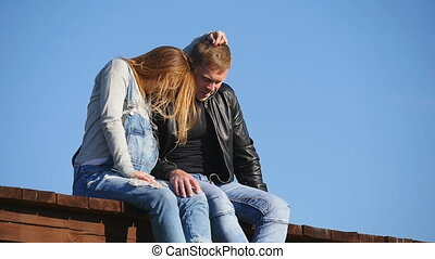 couple in love sitting on the roof