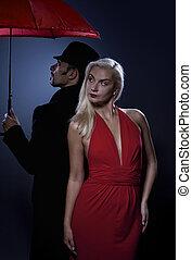 Couple in love standing under umbrella