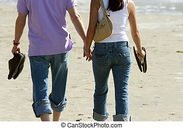 Couple in love - Couple walking on the beach