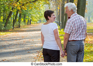 Couple in love - Elderly couple in love on a date in park