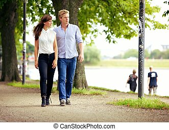 Couple in Love Strolling in a Park