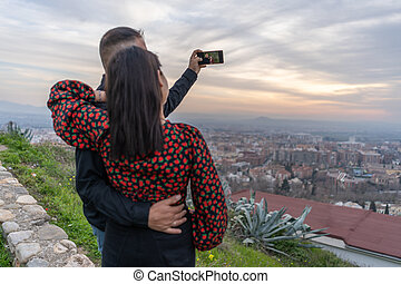 couple in love take a selfie at sunset