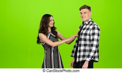 Couple in love, they laugh, kiss and have fun. Green screen