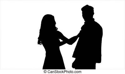 Couple in love, they laugh, kiss and have fun. Silhouette. White background