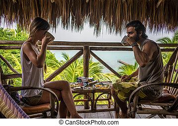 Couple eating Breakfast at Paradise Location. Bacalar Lagoon. Mexico adventure.