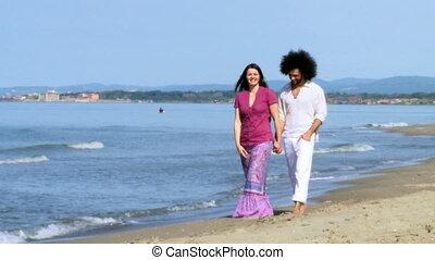 Couple in love walk on beach