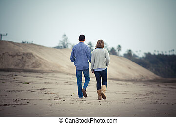 couple in love walking along the beach