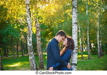 couple in love walking in the summer park