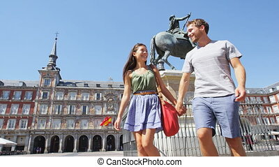 Couple in Madrid holding hands dating in Spain on Plaza ...