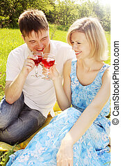 couple in meadow with wine