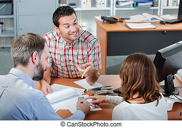 couple in meeting in office