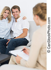 Couple in meeting with a financial adviser - Young couple in...