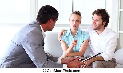 Couple in meeting with a financial adviser in his office