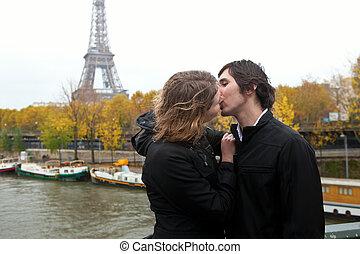 Couple in Paris, kissing at rain