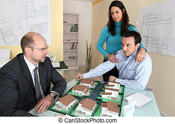 Couple in real estate agency