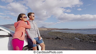 Couple in rental car traveling on vacation on Lanzarote ...