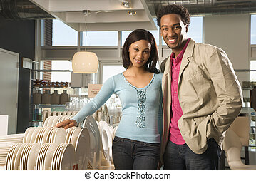 Couple in retail store. - Portrait of African American...