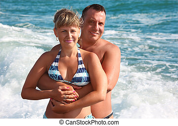 couple in sea waves