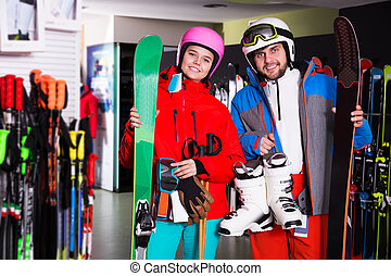 Couple in skiing outfit in store