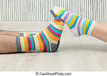couple in socks - feet of a beautiful couple with striped...