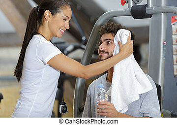 couple in sportswear in the gym after training