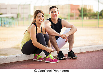 Couple in sporty outfit outdoors
