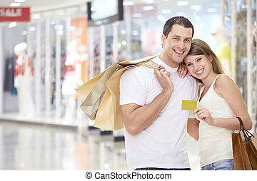 Couple in store with a credit card - The happy couple with a...