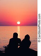 Couple in sunset at the sea. Batumi. Georgia