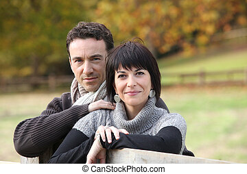 Couple in the autumnal countryside