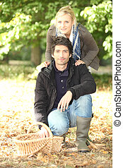 Couple in the field with basket