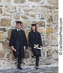 Couple in the Graduation Day - Young couple in the...