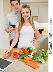 Couple in the kitchen drinking wine