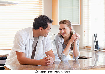 Couple in the kitchen looking at each other