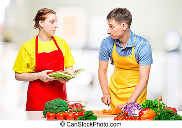 couple in the kitchen preparing fresh vegetable salad