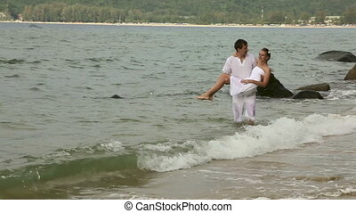 Couple in the ocean.