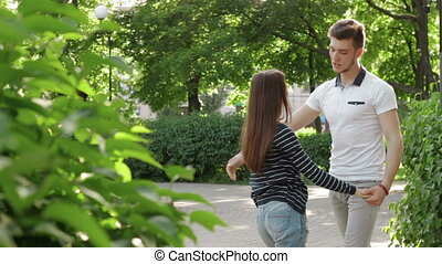 couple in the Park holding hands and cute talk
