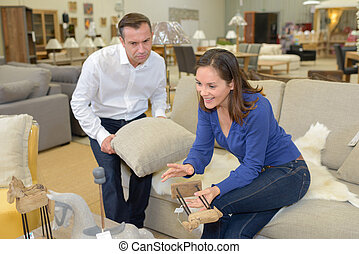 couple in the sofa an furniture store