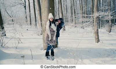 couple in the winter forest