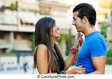Couple in urban background enjoying themselves