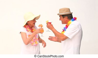 Couple in vacation drinking cocktails