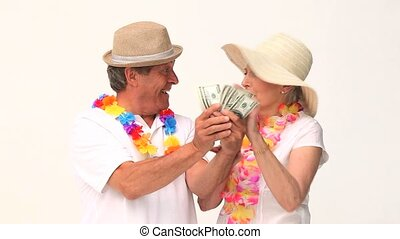 Couple in vacation showing off their cash against a white...
