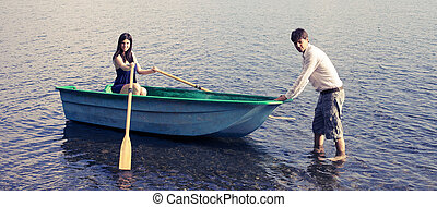 Couple in vacation with boat on lake