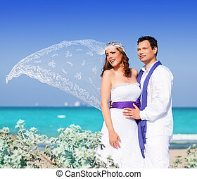 Couple in wedding day on beach sea