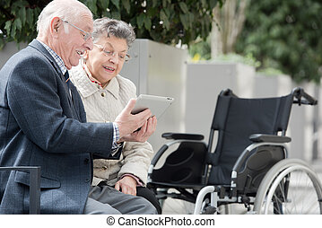 couple in wheelchair outside in nature