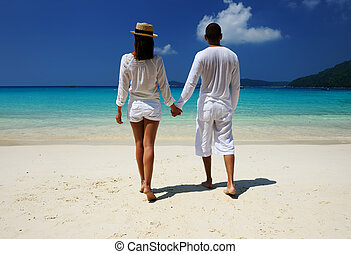 Couple in white on a beach