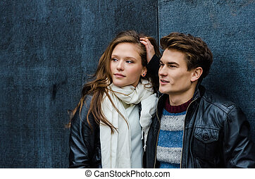 Couple In Winter Clothing Looking Away
