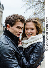 Couple In Winter Jackets Embracing
