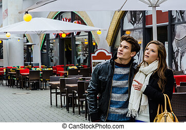 Couple In Winter Jackets Looking Away